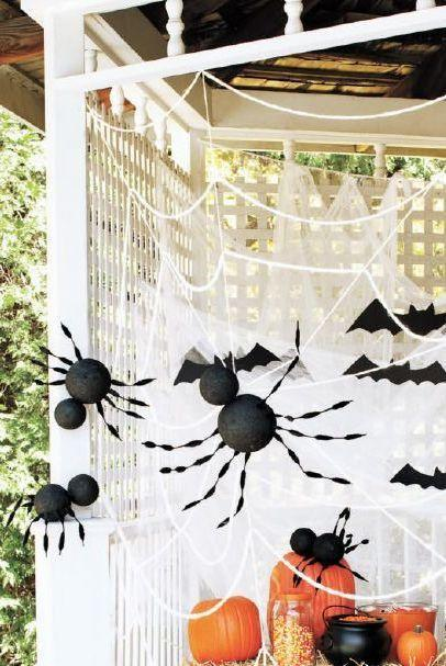 """<p>Party guests will duck for cover when they see this giant spiderweb display, complete with creepy giant spiders and bats.</p><p><strong><em><a href=""""https://www.womansday.com/home/decorating/a28902899/giant-spiders-and-spiderweb/"""" rel=""""nofollow noopener"""" target=""""_blank"""" data-ylk=""""slk:Get the Giant Spiders and Spiderwebs tutorial"""" class=""""link rapid-noclick-resp"""">Get the Giant Spiders and Spiderwebs tutorial</a>.</em></strong></p><p><a class=""""link rapid-noclick-resp"""" href=""""https://www.amazon.com/FloraCraft-Styrofoam-Balls-3-Inch-White/dp/B000140KPK?tag=syn-yahoo-20&ascsubtag=%5Bartid%7C10070.g.1908%5Bsrc%7Cyahoo-us"""" rel=""""nofollow noopener"""" target=""""_blank"""" data-ylk=""""slk:SHOP STYROFOAM BALLS"""">SHOP STYROFOAM BALLS</a></p>"""