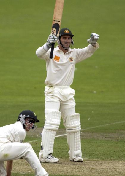 14 Dec  2001:  Justin Langer of Australia celebrates after reaching his 100 with a slogged four off South African Claude Henderson in the first day of the first test between Australia and South Africa played at Adelaide Oval in Adelaide, Australia.  DIGITAL IMAGE. Mandatory Credit: Tony Lewis/ALLSPORT
