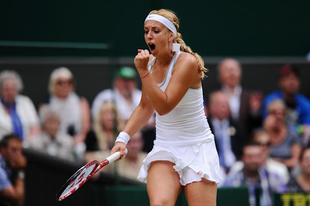 LONDON, ENGLAND - JULY 01: Sabine Lisicki of Germany celebrates a point during her Ladies' Singles fourth round match against Serena Williams of United States of America on day seven of the Wimbledon Lawn Tennis Championships at the All England Lawn Tennis and Croquet Club on July 1, 2013 in London, England. (Photo by Mike Hewitt/Getty Images)