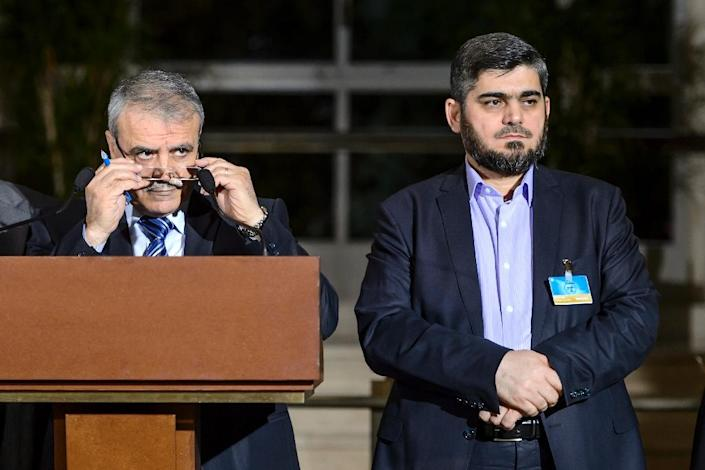 High Negotiations Committee (HNC) delegation head Asaad al-Zoabi (L) with HNC chief negotiator, Mohammed Alloush, during a press conference following Syria peace talks at the United Nations in Geneva on April 13, 2016 (AFP Photo/Fabrice Coffrini)