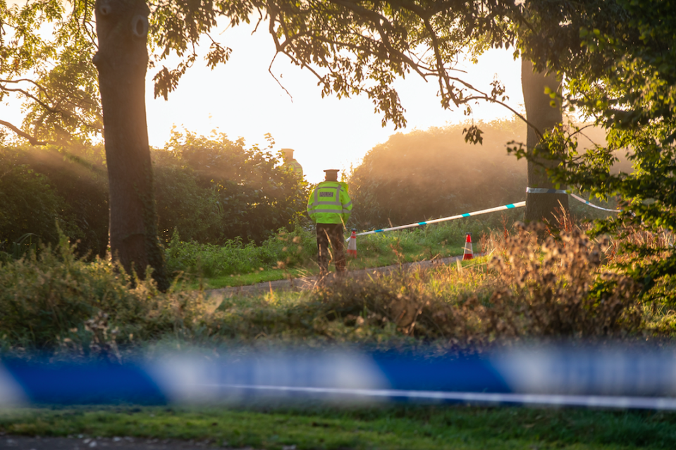 Police search Wiggington Park following the discovery of Keeley Bunker's body. (SWNS)