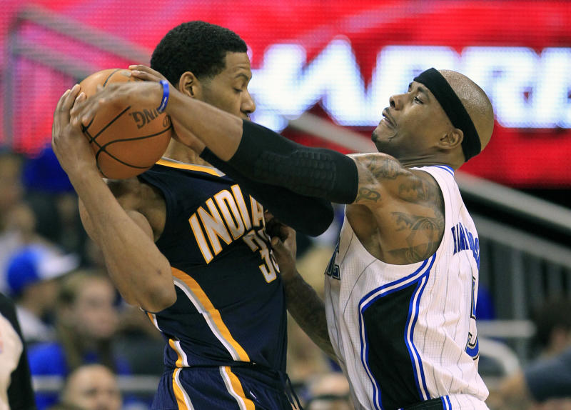Orlando Magic's Quentin Richardson, right, tries to get the ball away from Indiana Pacers' Danny Granger, left, during the first half of Game 3 of an NBA first-round playoff basketball series, Wednesday, May 2, 2012, in Orlando, Fla. (AP Photo/John Raoux)