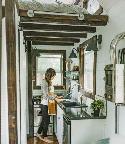 <p>Although (very) small, this cooking space features a a 24-inch under-counter fridge, a 20-inch four-burner gas range, and ample granite counter space.</p>