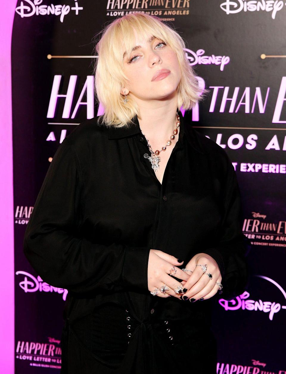 <p>Billie Eilish sports short hair and wears all black to her <em>Happier Than Ever: A Love Letter to Los Angeles</em> worldwide premiere at The Grove on Aug. 30 in L.A.</p>
