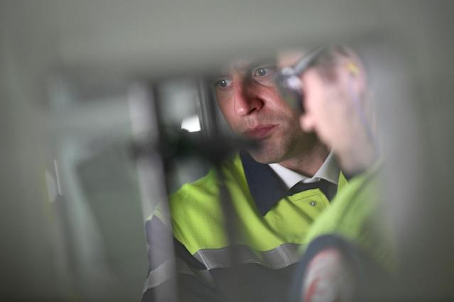 <p>French presidential election candidate for the En Marche ! movement Emmanuel Macron, right, visits the VOA glass-making company during a campaign trip in Albi, southwestern France, Thursday, May 4, 2017. French centrist Emmanuel Macron has already achieved an immense task: a former outsider with little political experience, he is now the front-runner in France's presidential race, banking on the promise to reform the country through radical pro-business measures and pro-European policies. (Eric Feferberg/Pool Photo via AP) </p>