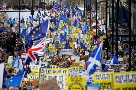 EU supporters, calling on the government to give Britons a vote on the final Brexit deal, participate in the 'People's Vote' march in central London, Britain March 23, 2019. REUTERS/Henry Nicholls