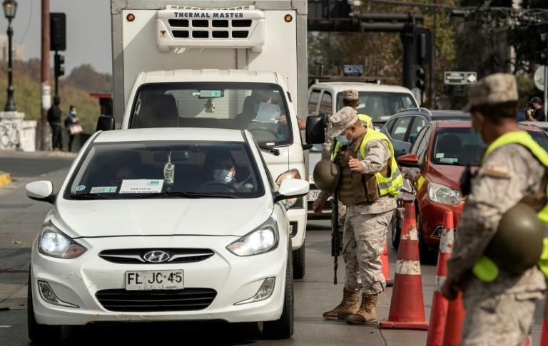 Soldiers stop drivers on March 25, 2021, in Santiago, the capital of Chile -- where the government is aiming to immunize 15 million people by June 30