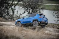 "<p>Under the right circumstances, the subcompact <a href=""https://www.caranddriver.com/jeep/compass"" rel=""nofollow noopener"" target=""_blank"" data-ylk=""slk:Jeep Compass"" class=""link rapid-noclick-resp"">Jeep Compass</a> in Trailhawk guise can be an effective off-road warrior. The Trailhawk features enhanced all-wheel-drive system and an exclusive 20:1 crawl ratio, while the suspension is modified for additional ground clearance and a better approach angle than ordinary Compass models. The Trailhawk's selectable traction-control software includes a Rock mode to help wrestle with the tough stuff. This Compass wears special badges and decals, bright-red tow hooks, and aggressive 17-inch wheels wrapped with Falken all-season tires.</p>"