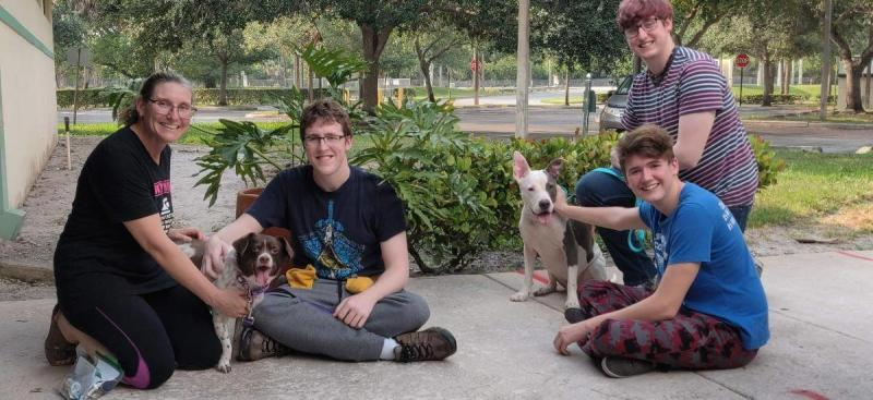 The Moffett family and their dogs, Skye and Hazel, that they adopted this week from the West Palm Beach shelter. (Photo courtesy of Friends of West Palm Beach County Animal Care and Control)