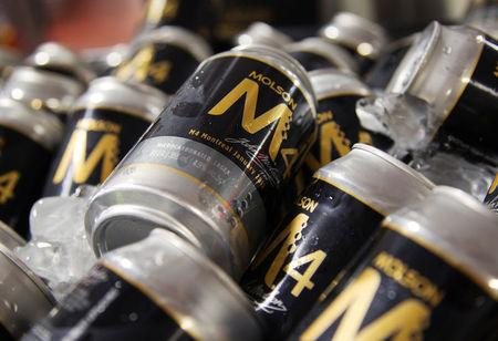 FILE PHOTO: Cans of Molson beer are seen at a news conference in Montreal