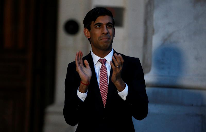 Chancellor Rishi Sunak clapping outside the Foreign and Commonwealth Office in London to salute local heroes during Thursday's nationwide Clap for Carers NHS initiative to applaud NHS workers fighting the coronavirus pandemic.