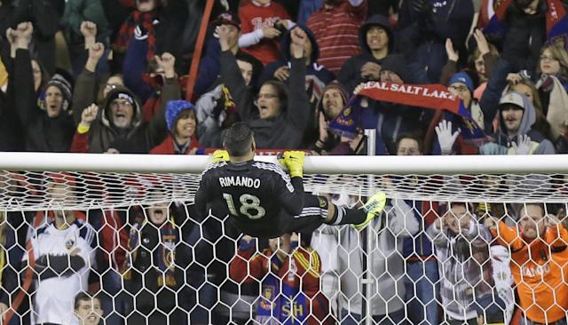 CORRECTS SCORE - Real Salt Lake goalie Nick Rimando (18) celebrates at the end of their second leg of the MLS Western Conference semifinal against the Los Angeles Galaxy Thursday, Nov. 7, 2013, in Sandy, Utah. Real Salt Lake won 2-0. (AP Photo/Rick Bowmer)