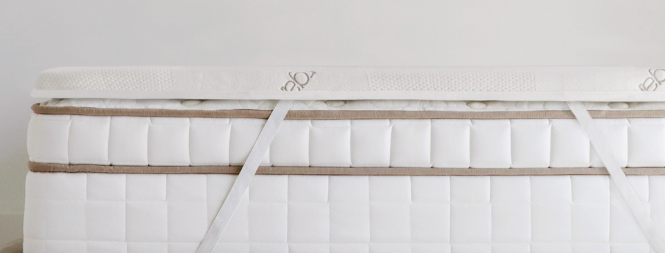 """<h2>Saatva Foam Mattress Topper</h2><br>Saatva makes three types of mattress toppers, all of which are made with 100% organic certified cotton, and designed to blend seamlessly with your existing mattress. This version features 1.5 inches of high-density foam, which adds an extra layer of support and even bodyweight distribution. <br><br><strong>Eco-Sleepers Say:</strong> """"Top quality zen haven bed, topper, and pillow. I will look to them first for any future bedding needs."""" — <em>Perry</em>, <em>Saatva reviewer</em><br><br><em>Shop <strong><a href=""""https://www.saatva.com/bedding/mattress-topper"""" rel=""""nofollow noopener"""" target=""""_blank"""" data-ylk=""""slk:Saatva"""" class=""""link rapid-noclick-resp"""">Saatva</a></strong></em><br><br><strong>Saatva</strong> Foam Mattress Topper, $, available at <a href=""""https://go.skimresources.com/?id=30283X879131&url=https%3A%2F%2Fwww.saatva.com%2Fbedding%2Fmattress-topper"""" rel=""""nofollow noopener"""" target=""""_blank"""" data-ylk=""""slk:Saatva"""" class=""""link rapid-noclick-resp"""">Saatva</a>"""