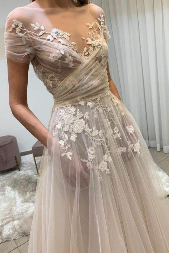 Wedding gown see-through divides fans