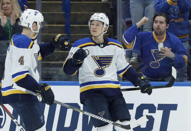St. Louis Blues' Nikita Soshnikov, of Russia, is congratulated by Carl Gunnarsson, left, of Sweden, after scoring during the second period of an NHL hockey game against the New York Rangers on Saturday, March 17, 2018, in St. Louis. (AP Photo/Jeff Roberson)
