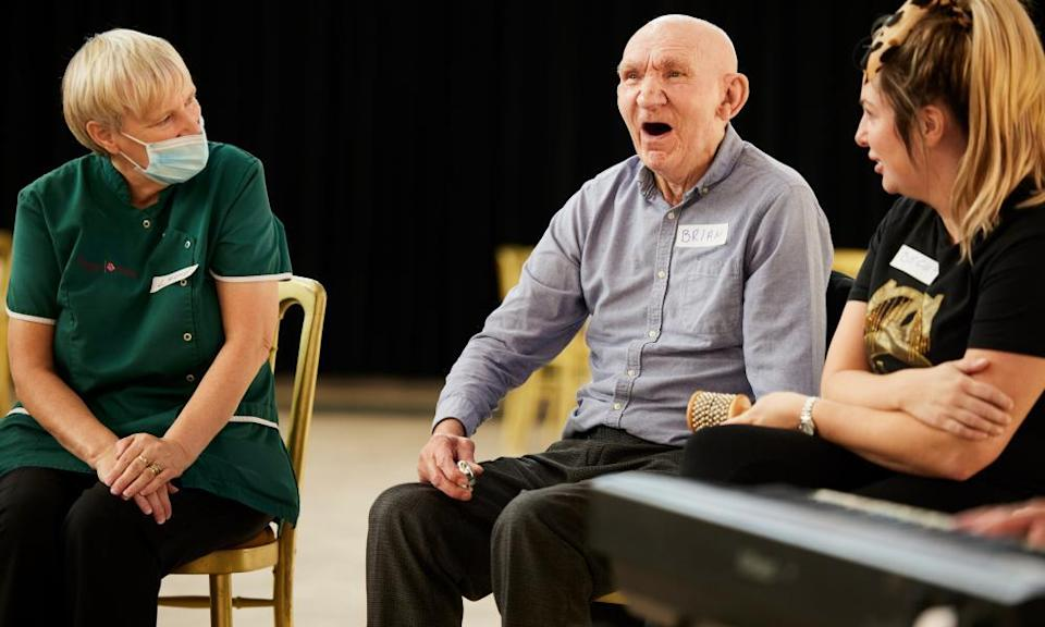 A music cafe participant and a carer taking part