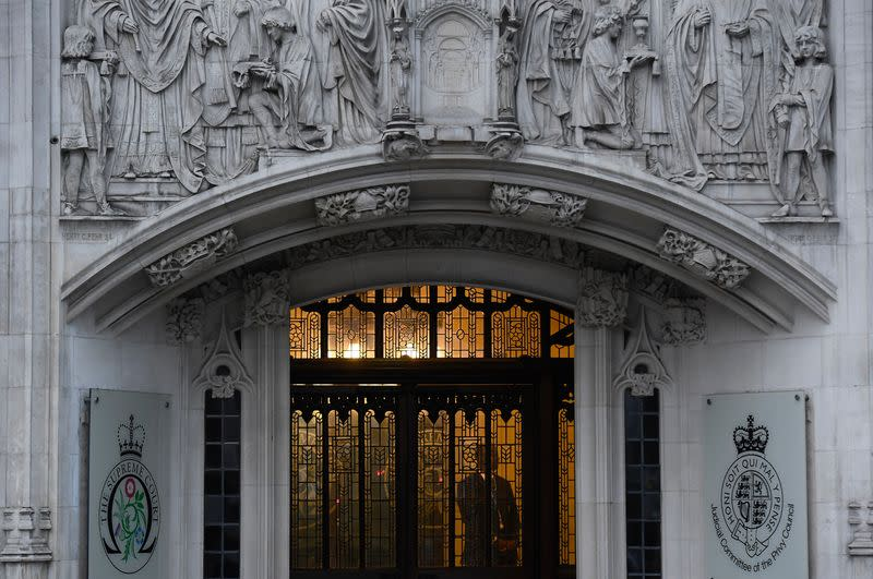 FILE PHOTO: A member of security stands guard inside the Supreme Court in London