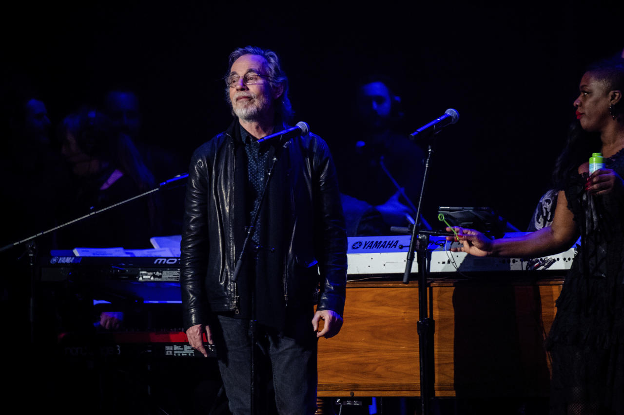 Jackson Browne, left, performs at Love Rocks NYC!, a Benefit Concert for God's Love We Deliver at the Beacon Theatre on Thursday, March 12, 2020 in New York. (Photo by Amy Harris/Invision/AP)