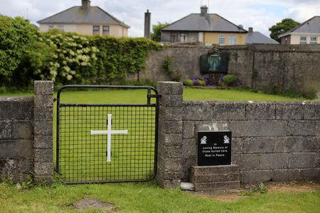 FILE PHOTO: The entrance to the site of a mass grave of hundreds of children who died in the former Bons Secours home for unmarried mothers is seen in Tuam, County Galway, Ireland, June 4, 2014.  REUTERS/Stringer/File Photo