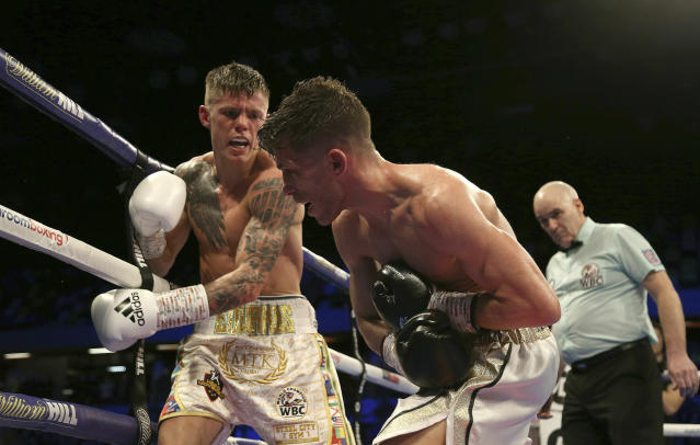 Charlie Edwards, left, fights against Angel Moreno in their World Boxing Council World Flyweight Title bout at the Copper Box Arena, London. (Paul Harding/PA via AP)