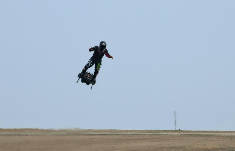 """Franky Zapata is set to test his jet-powered hoverboard or """"flyboard"""" with a flight between France and Britain across the English Channel (AFP Photo/DENIS CHARLET)"""