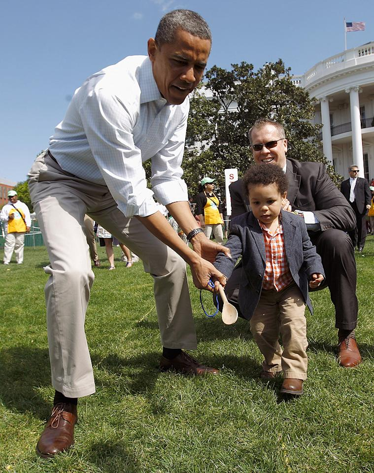 Even the president loves a good Easter egg hunt! On Monday, Barack Obama helped out a young boy during the White House Easter Egg Roll on the South Lawn, a tradition that was started by President Rutherford B. Hayes back in 1878. (4/9/2012)