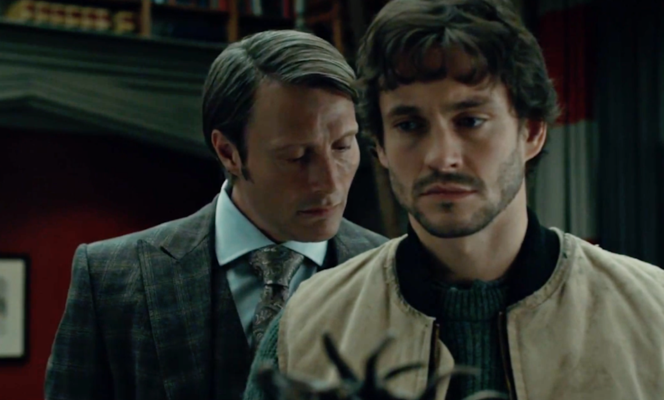 Hannibal Lecter leans in to smell the back of Will Graham's neck as he is turned away from him