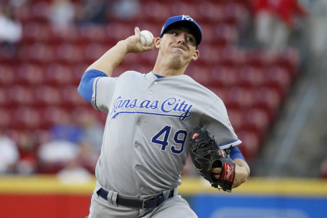 Kansas City Royals starting pitcher Heath Fillmyer throws during the first inning of the team's baseball game against the Cincinnati Reds, Wednesday, Sept. 26, 2018, in Cincinnati. (AP Photo/John Minchillo)