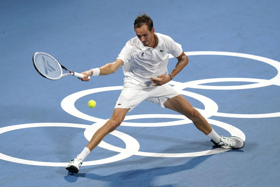 Daniil Medvedev, of the Russian Olympic Committee, returns to Pablo Carreno Busta, of Spain, during the quarterfinal round of the men's tennis competition at the 2020 Summer Olympics, Thursday, July 29, 2021, in Tokyo, Japan. (AP Photo/Patrick Semansky)