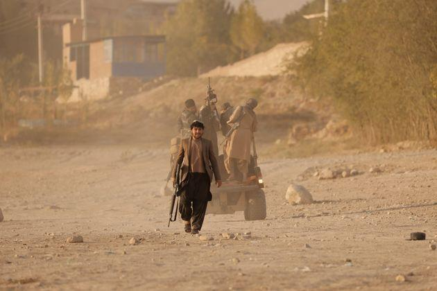 A Taliban fighter walks as he and others take a day off to visit the amusement park at Kabul's Qargha reservoir, at the outskirts of Kabul, Afghanistan October 8, 2021. Picture taken October 8, 2021. REUTERS/Jorge Silva (Photo: Jorge Silva via Reuters)