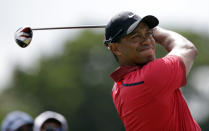 Tiger Woods hits from the third tee during the final round of the Cadillac Championship golf tournament on Sunday, March 9, 2014, in Doral, Fla. (AP Photo/Wilfredo Lee)