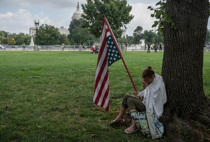 """<div class=""""inline-image__caption""""><p>Geraldine Lovell from Maryland cries under a tree during the """"Justice for J6"""" rally.</p></div> <div class=""""inline-image__credit"""">Andrew Caballero-Reynolds/Getty</div>"""