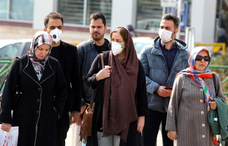 Some Iranians have begun wearing face masks amid a deadly coronavirus outbreak