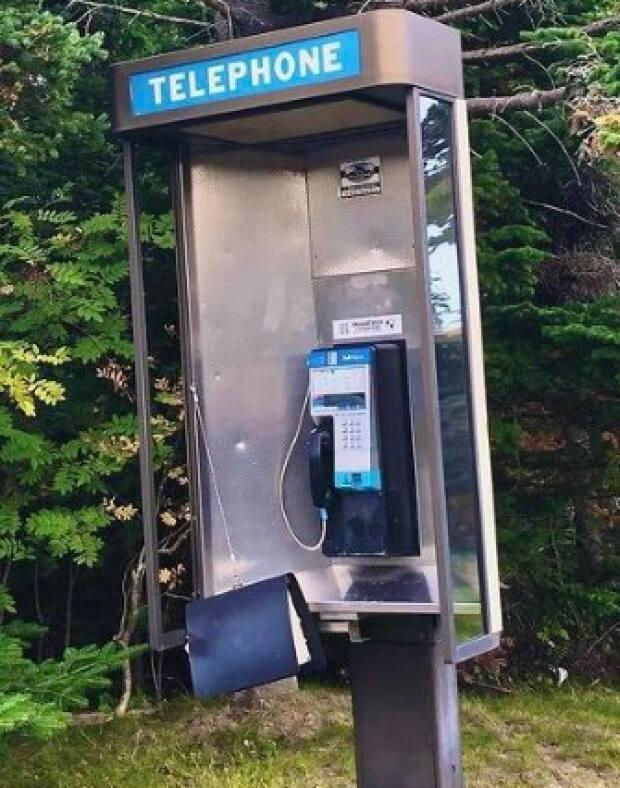Payphones may be less noticeable in daily life, but some still exist in parts of Newfoundland and Labrador. (Shannon Reardon/Twitter - image credit)
