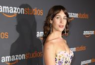 <p>Lola Kirke showed her disdain for Paul Ryan with a pin that perfectly matched her Andrew Gn dress at the Globes. (Photo: Getty Images) </p>