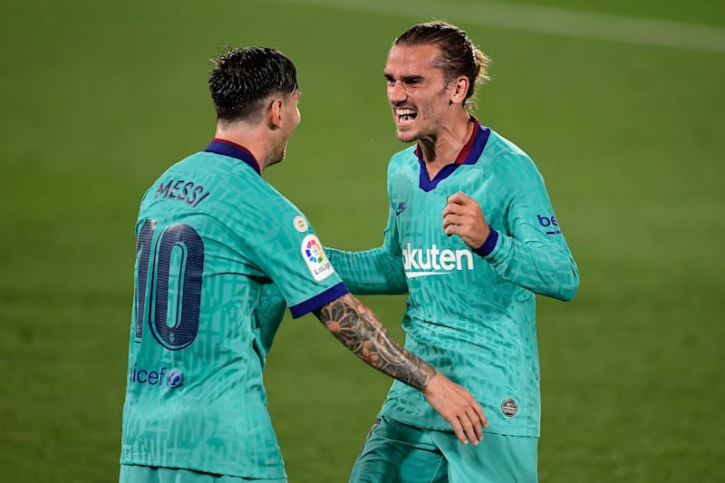 Barcelona's French forward Antoine Griezmann (R) celebrates with Barcelona's Argentine forward Lionel Messi after scoring a goal during the Spanish League football match between Villarreal and Barcelona at the Madrigal stadium in Villarreal on July 5, 2020. (Photo by JOSE JORDAN / AFP) (Photo by JOSE JORDAN/AFP via Getty Images)