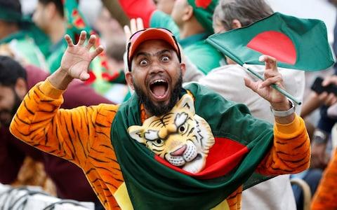 A Bangladesh fan celebrates the wicket of West Indies Andre Russell - Credit: Action Images via Reuters/Paul Childs