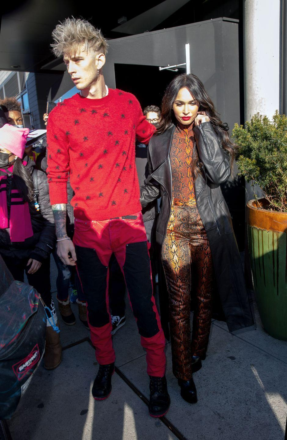 <p>Fox opted for a bold red snakeprint pair of trousers and matching high neck top ahead of her beau's TV appearance. She styled the look with a black leather jacket and a red lip. </p>