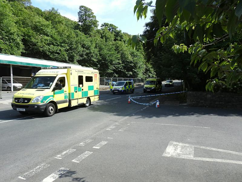 Police on the scene on Abbey Road in Dalton, Cumbria, where three pedestrians have died following a road traffic collision. June 21 2020. See SWNS story SWLEcrash, Three pedestrians have died following a collision in Dalton, police said. The incident happened at around 2.30pm yesterday on Abbey Road. Police said emergency services were called the report of a road traffic collision involving one vehicle and three pedestrians. The names, ages and the relationship of the pedestrians have yet to be confirmed by police. The vehicle involved was a Peugeot, officers said. As a result of the collision three pedestrians were pronounced dead at the scene.