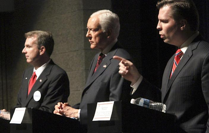 FILE - In this April 4, 2012, file photo, Sen. Orrin Hatch, center, faces off with Republican candidates for U.S. Senate Chris Herrod, left, and and Dan Liljenquist, during a debate sponsored by the Utah League of Women Voters in Salt Lake City. Hatch and his two key challengers, former state Sen. Liljenquist and state Rep. Herrod, have been appearing every day, several times a day, at restaurants, in backyards and at school libraries with mere handfuls of people, trying to secure votes one delegate at a time.(AP Photo/The Salt Lake Tribune, Rick Egan, File) DESERET NEWS OUT; LOCAL TV OUT; MAGS OUT
