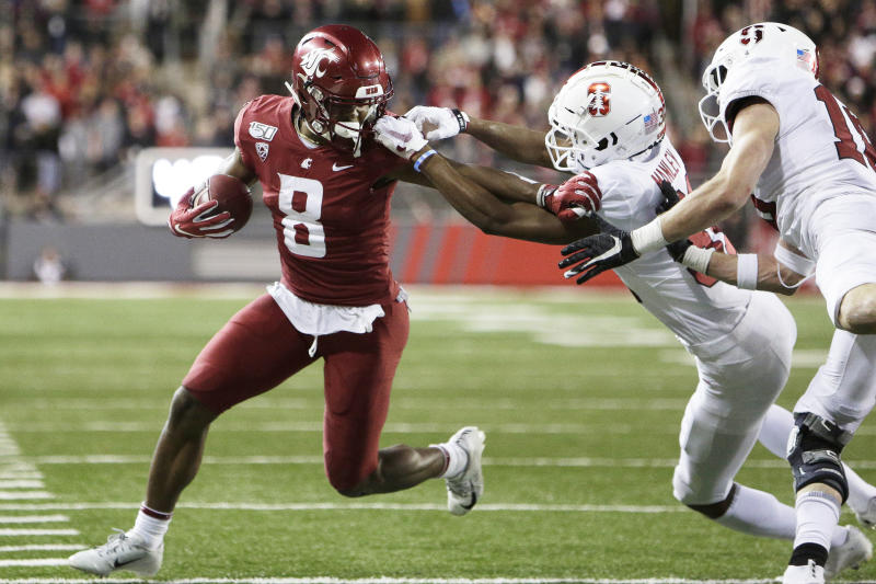 Washington State wide receiver Easop Winston Jr., left, carries the ball while pressured by Stanford cornerback Zahran Manley, center, and safety Stuart Head during the second half of an NCAA college football game in Pullman, Wash., Saturday, Nov. 16, 2019. Washington State won 49-22. (AP Photo/Young Kwak)