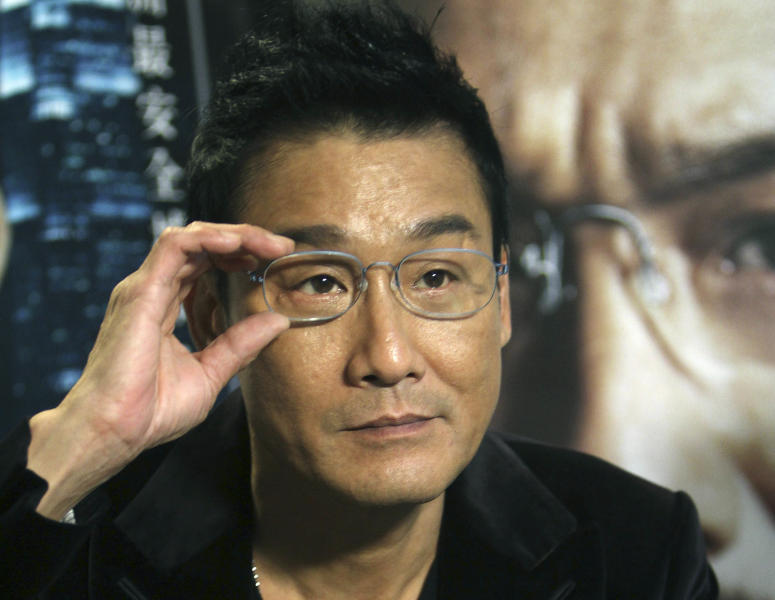 "In this photo taken on Monday, Nov. 12, 2012, Hong Kong actor Tony Leung Ka Fai speaks during an interview for his new film ""Cold War"" in Taipei, Taiwan. (AP Photo/Chiang Ying-ying)"