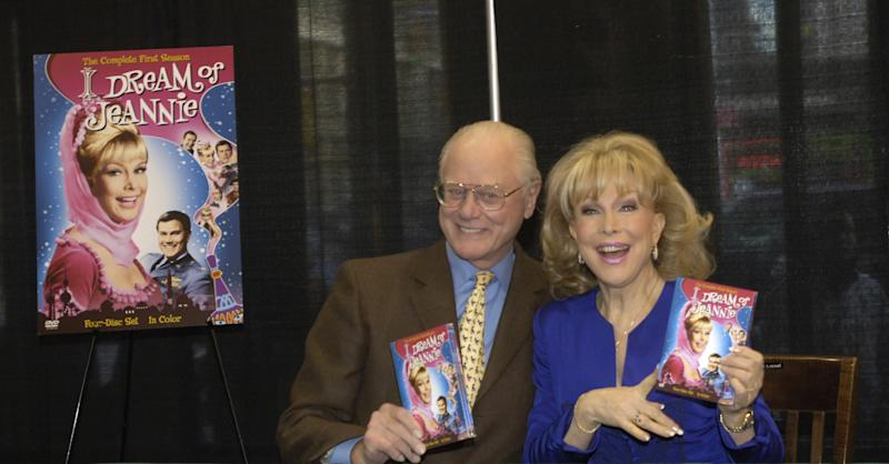 "FILE - In this Wednesday, March 15, 2006 file photo, ""I Dream of Jeannie"" co-stars Barbara Eden and Larry Hagman pose for photos before signing copies of the newly-released first season DVD of their television show at a bookstore in New York. Actor Larry Hagman, who for more than a decade played villainous patriarch JR Ewing in the TV soap Dallas, has died at the age of 81, his family said Saturday Nov. 24, 2012. (AP Photo/Jason DeCrow)"
