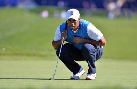 Jan 26, 2017; La Jolla, CA, USA; Tiger Woods lines up a putt on the 1st green during the first round of the Farmers Insurance Open golf tournament at Torrey Pines Municipal Golf Course. Orlando Ramirez-USA TODAY Sports
