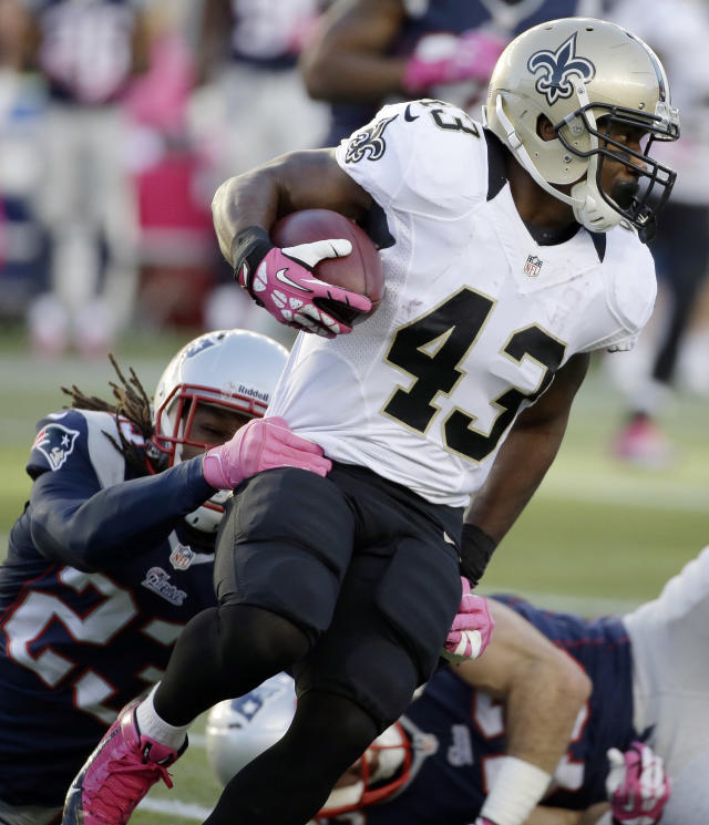 New England Patriots defensive back Marquice Cole (23) tackles New Orleans Saints running back Darren Sproles (43) in the first quarter of an NFL football game Sunday, Oct.13, 2013, in Foxborough, Mass. (AP Photo/Stephan Savoia)