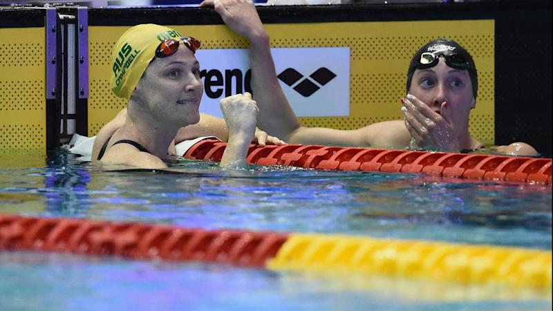 Cate Campbell (left) has claimed gold for Australia in the 100m freestyle at the Pan Pacs in Tokyo