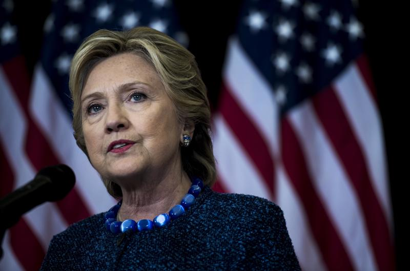 Former Democratic candidate for President of the United States Hillary Clinton speaks to journalists to comment on the FBI investigation concerning Clinton's private emails, Oct. 28, 2016. | Melina Mara—The Washington Post/Getty Images