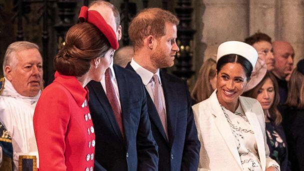 PHOTO: Britain's Catherine, Duchess of Cambridge, talks with Britain's Meghan, Duchess of Sussex, Prince William and Prince Harry stand by attending the Commonwealth Day service at Westminster Abbey in London on March 11, 2019. (Pool via AFP/Getty Images)