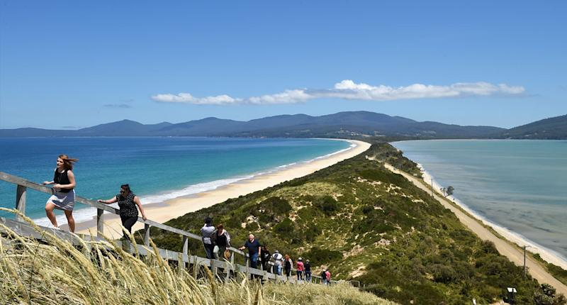 Tourists walk to a lookout at 'The Neck' on Bruny Island, off south eastern Tasmania. Source: AAP, file