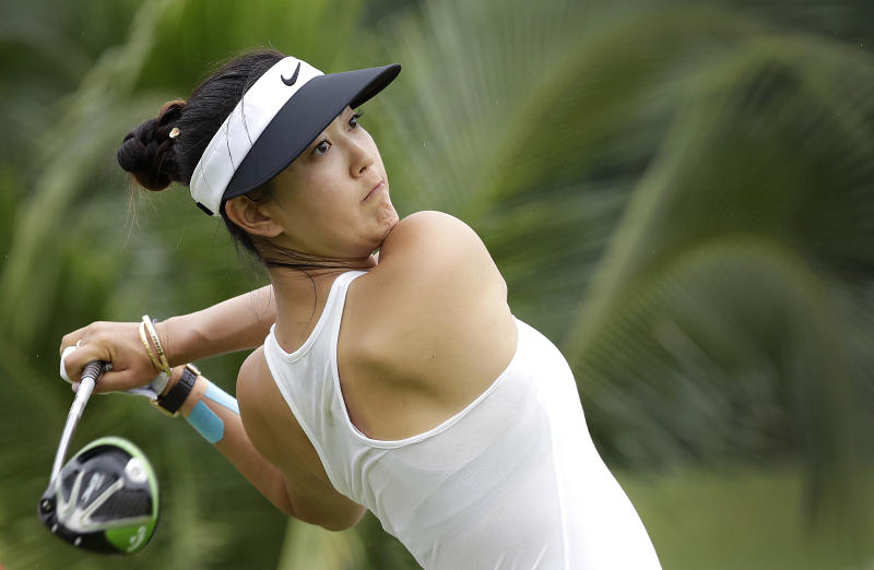 Michelle Wie withdraws from LPGA Singapore with five tied for lead